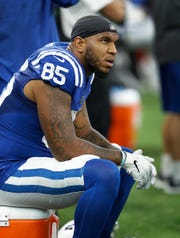 Colts tight end Eric Ebron (85) sits dejected against the Raiders.
