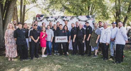 Food Network chef Alex Guarnaschelli and IndyStar food writer Liz Biro join chefs from Indianapolis' best restaurants for a group photo during the IndyStar Wine & Food Experience Sept. 28 at Clay Terrace in Carmel.