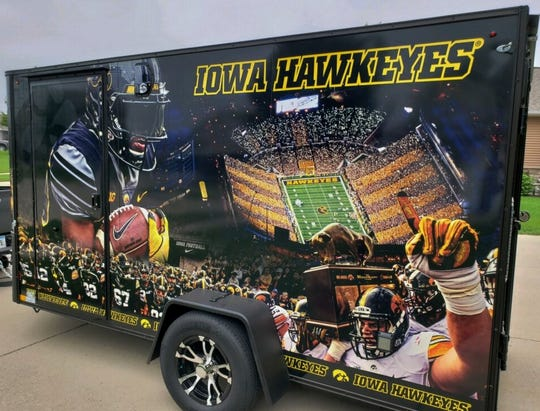 This impressive graphic of a packed Kinnick Stadium at night and a hard-charging Akrum Wadley at left covers one side of the Smith tailgate trailer. You can see the outline of the door to the large bathroom.