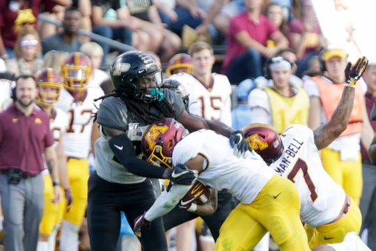 Purdue safety Cory Trice (23) stops Minnesota running back Rodney Smith (1) during the fourth quarter of an NCAA football game, Saturday, Sept. 28, 2019 at Ross-Ade Stadium in West Lafayette. Minnesota won, 38-31.