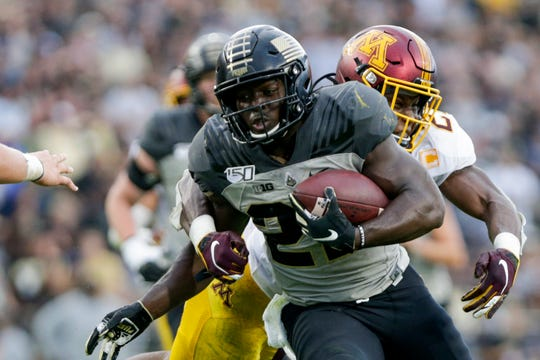 Minnesota defensive back Phillip Howard (2) comes behind Purdue running back King Doerue (22) as he runs the ball into the end zone for a touchdown during the fourth quarter of a NCAA football game, Saturday, Sept. 28, 2019 at Ross-Ade Stadium in West Lafayette. Minnesota won, 38-31.