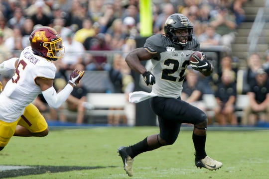 Purdue running back King Doerue (22) runs the ball past Minnesota defensive back Chris Williamson (6) during the first quarter of a NCAA football game, Saturday, Sept. 28, 2019 at Ross-Ade Stadium in West Lafayette.