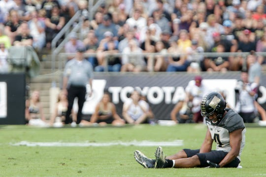 Purdue wide receiver Rondale Moore (4) rests on the field after an injury during the first quarter of a NCAA football game, Saturday, Sept. 28, 2019 at Ross-Ade Stadium in West Lafayette.