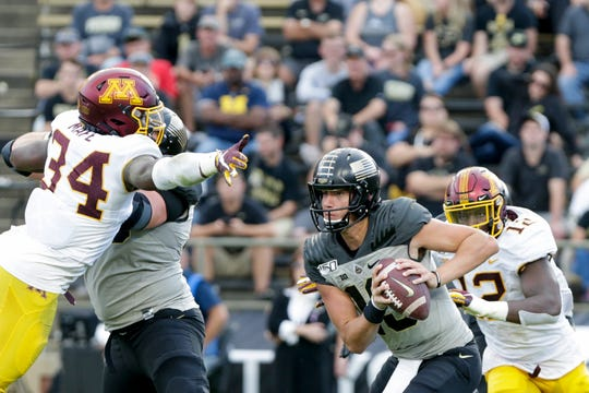 Minnesota defensive linebacker Boye Mafe (34) dives for Purdue quarterback Jack Plummer (13) as he looks for a solution during the fourth quarter of a NCAA football game, Saturday, Sept. 28, 2019 at Ross-Ade Stadium in West Lafayette. Minnesota won, 38-31.