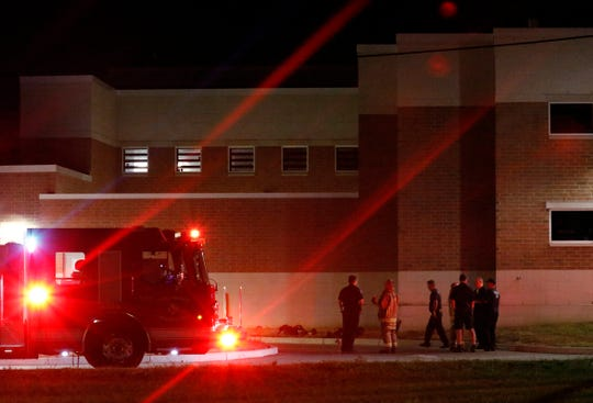 Lancaster firefighters stand outside the Fairfield County Jail Saturday night, Sept. 28, 2019, in Lancaster. Firefighters were called the jail after three employees reported feeling ill with similar symptoms.
