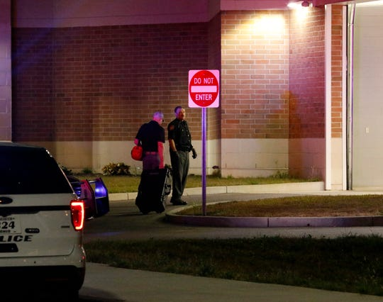 Major Crimes Unit Sgt. Lee Hawks carries his equipment into the sally port at the Fairfield County Jail Saturday night, Sept. 28, 2019, in Lancaster. Hawks was called to the jail to investigate if three sheriff's office employees were exposed to a substance that made them ill.