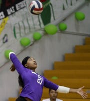 Male's Madison Rice-Locket serves against Providence.