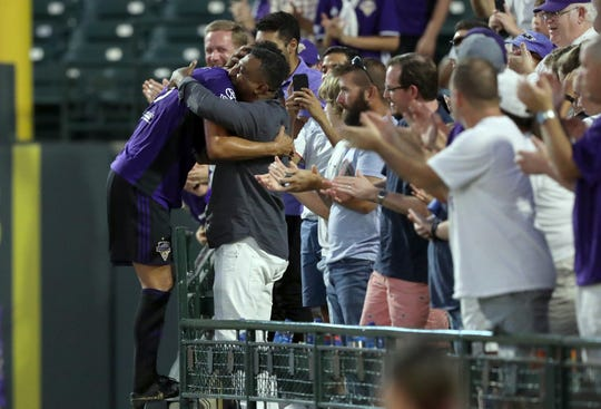 Louisville City FC's Paco Craig (5) celebrates with his team after scoring a goal against the Tampa Bay Rowdies during their game at Slugger Field in Louisville, Ky.  Sept. 28,  2019.