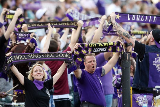 Louisville City FC's fans cheer for their team during their games against the Tampa Bay Rowdies at Slugger Field in Louisville, Ky.  Sept. 28,  2019.