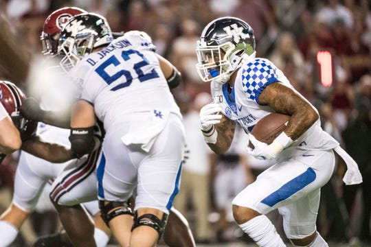 Kentucky running back A.J. Rose (10) carries the ball against South Carolina during the first half of an NCAA college football game Saturday in Columbia, S.C.
