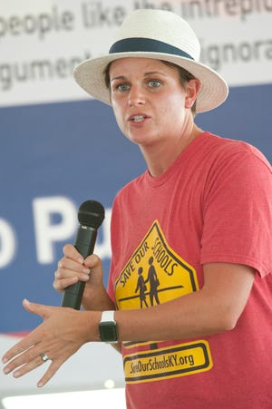 """Tiffany Dunn, a 7-year member of the Jefferson County Teachers Association and Kentucky co-founder of """"Save Our Schools,"""" speaks at the """"Bullied by Bevin: Restore Civility in Public Service"""" picnic sponsored by state Sen. Dan Seum. Sept. 28, 2019"""