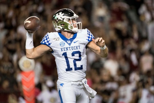 Kentucky quarterback Sawyer Smith (12) attempts a pass against South Carolina during the first half Saturday in Columbia, S.C. (AP Photo/Sean Rayford)