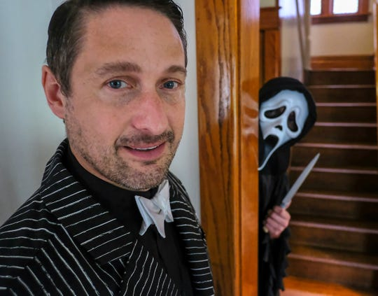 "Century 21 Realtor James Pyle is happy with the response of people viewing his Zillow listing for a house at 809 Chestnut Street in Lansing, which includes friend Andrew Lamkin dressed as the ""Scream"" character, Ghostface, Sunday, Sept. 29, 2019."