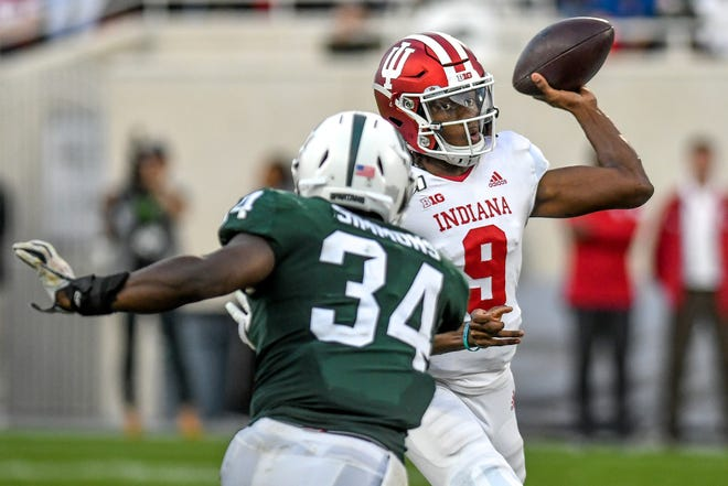 Michigan State's Antjuan Simmons, left, closes in on Indiana's quarterback Michael Penix Jr. during the fourth quarter on Saturday, Sept. 28, 2019, in East Lansing.