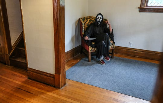 "Andrew Lamkin portrays Ghostface from the movie ""Scream"" at an realty open house Sunday, Sept. 29, 2019."