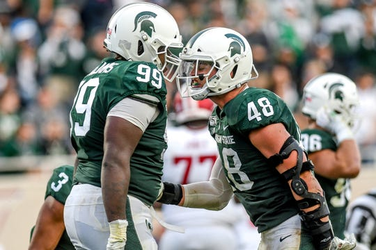 Michigan State's Raequan Williams, left, celebrates his sack with Kenny Willekes during the fourth quarter on Saturday, Sept. 28, 2019, in East Lansing.