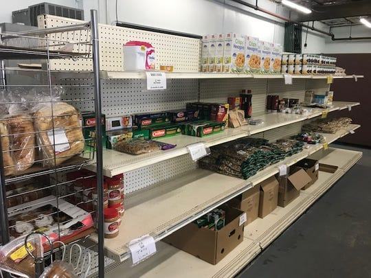 Shelves look empty at the Two Rivers-Mishicot Ecumenical food pantry.