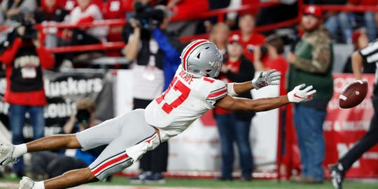 A potential touchdown bomb lands just beyond the reach of wide open Ohio State receiver Chris Olave