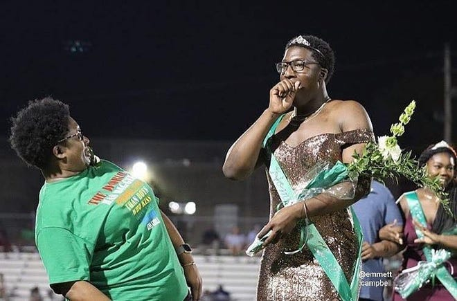 White Station High School senior Brandon Allen, 17, gets crowned 'Homecoming Royalty' on Friday.