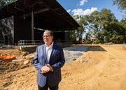 Germantown Performing Arts Center Executive Director Paul Chandler stands in front of The Grove, GPAC's outdoor venue, on Friday, Sept. 27, 2019.