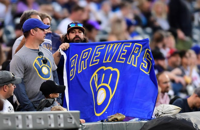 Milwaukee Brewers fans fly the retro-logo flag during the first inning against the Colorado Rockies at Coors Field.