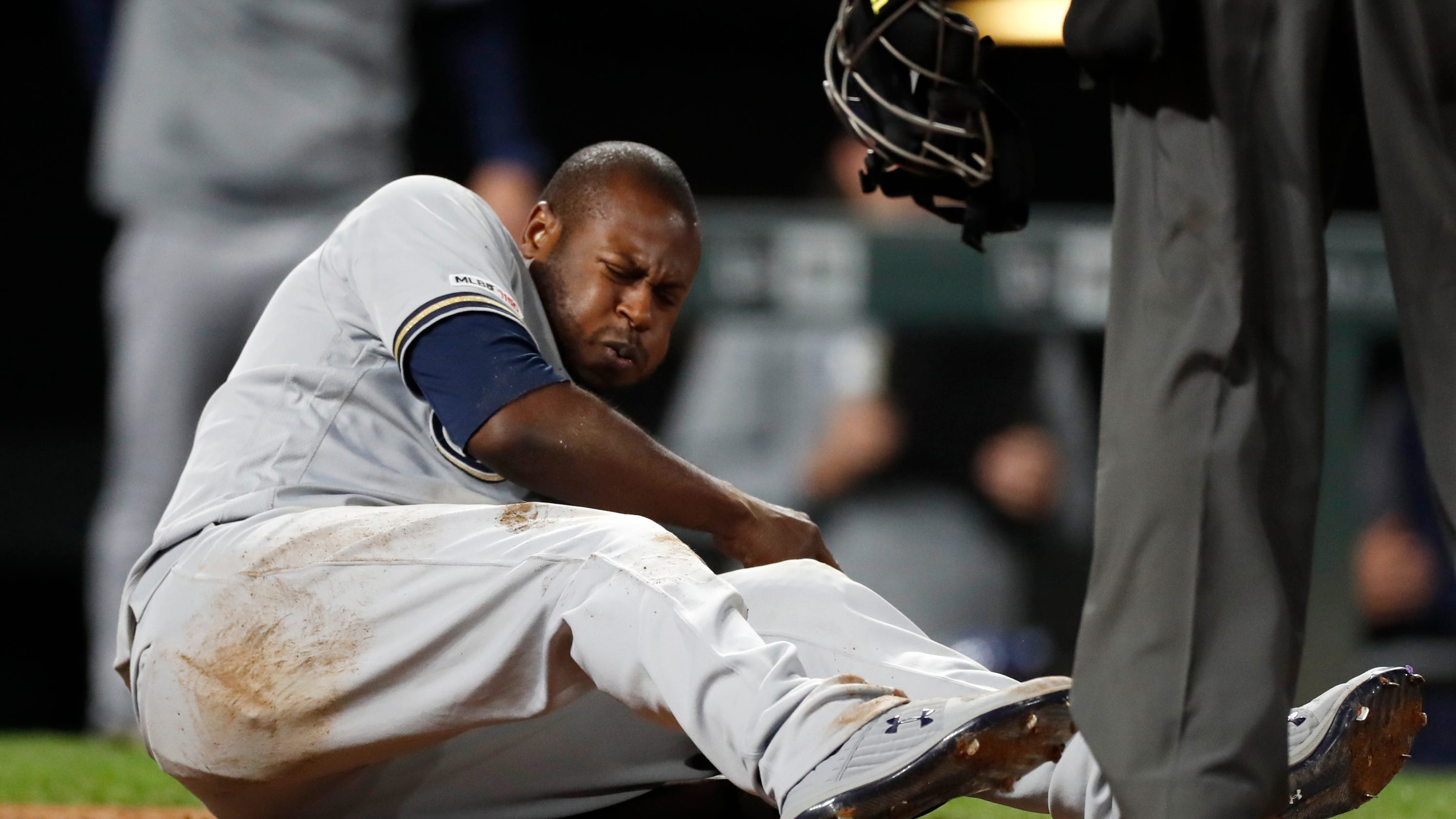 Brewers' Lorenzo Cain injured in gut-wrenching loss to Rockies