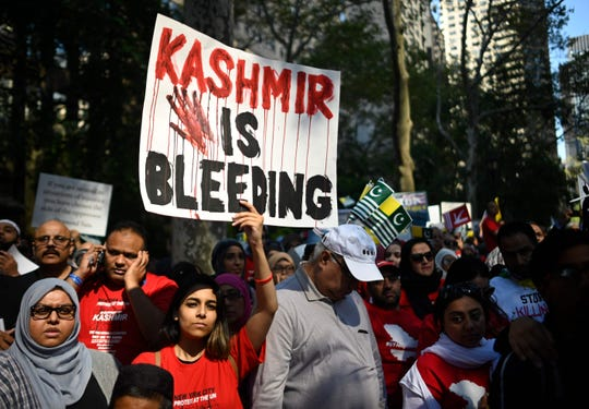 People gather during a protest in solidarity with the people of Kashmir outside the United Nations headquarters in New York on Sept. 27 in New York  Photo by JOHANNES EISELE/AFP/Getty Images