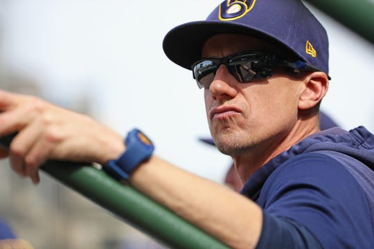 Brewers manager Craig Counsell watches as his team takes on the Chicago Cubs at Wrigley Field on Aug. 30.