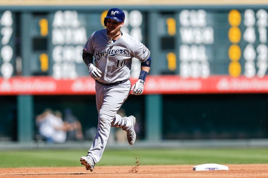 Brewers catcher Yasmani Grandal rounds the bases after a two-run homer against the Rockies in the final week of the 2019 season.