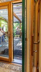 Triple-paned windows, thick doors keep heat loss to a minimum in energy efficient homes like this one in Wisconsin.