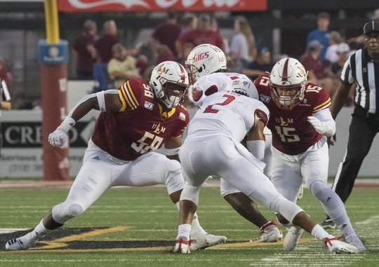 ULM's Donald Louis (58) and Austin Hawley (15) sack South Alabama quarterback Cephus Johnson (2) in a 30-17 win at JPS Field at Malone Stadium  on Sept. 28. WIns over the Jaguars and Texas State evened the Warhawks' record to 3-3 and 2-0 in the Sun Belt Conference.