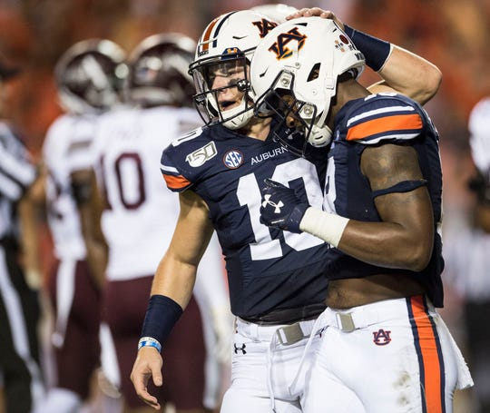 Auburn quarterback Bo Nix (10) celebrates with Auburn wide receiver Seth Williams (18) after their touchdown connection at Jordan-Hare Stadium in Auburn, Ala., on Saturday, Sept. 28, 2019.