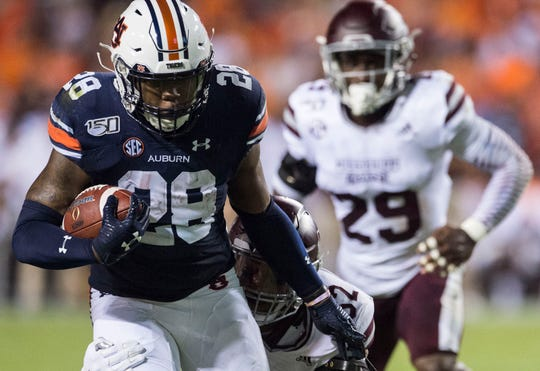 Auburn running back JaTarvious Whitlow (28) runs the ball at Jordan-Hare Stadium in Auburn, Ala., on Saturday, Sept. 28, 2019. Auburn leads Mississippi State 42-9 at halftime.