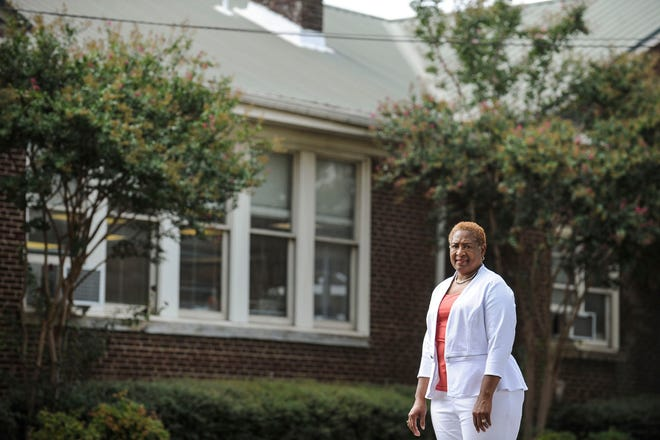 This Sept. 17 2019 photo shows historian Peggy Towns in front of the former Carver School (now Horizon School), which in 1935 was visited by George Washington Carver in Decatur, Ala. Local historians hope to place a historical marker at the site.  (Jeronimo Nisa/The Decatur Daily via AP)