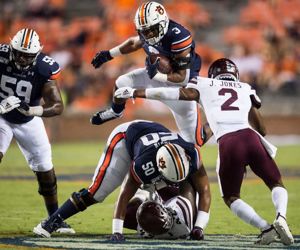 Auburn running back DJ Williams (3) attempts to hurdle a blocker at Jordan-Hare Stadium in Auburn, Ala., on Saturday, Sept. 28, 2019. Auburn defeated Mississippi State 56-23.