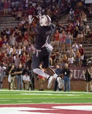 Troy wide receiver Kaylon Geiger (1) catches a high pass to the undone during the fourth quarter.