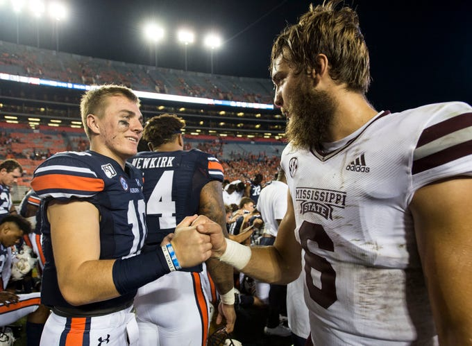 Auburn quarterback Bo Nix (10) and Mississippi State quarterback Garrett Shrader (6) shake hands after the game at Jordan-Hare Stadium in Auburn, Ala., on Saturday, Sept. 28, 2019. Auburn defeated Mississippi State 56-23.