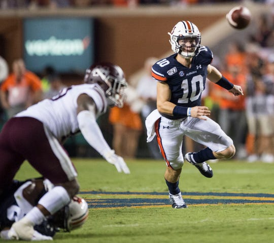 Auburn quarterback Bo Nix (10) tracks down a fumble lost by Auburn running back Shaun Shivers (8) at Jordan-Hare Stadium in Auburn, Ala., on Saturday, Sept. 28, 2019. Auburn defeated Mississippi State 56-23.