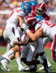 Alabama defensive back Xavier McKinney (15) stops Ole Miss quarterback John Rhys Plumlee (10) at Bryant-Denny Stadium in Tuscaloosa, Ala., on Saturday September 28, 2019.