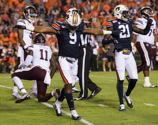 Auburn defensive backs Jamien Sherwood (9) and Smoke Monday (21) celebrate after making a play at Jordan-Hare Stadium in Auburn, Ala., on Saturday, Sept. 28, 2019. Auburn defeated Mississippi State 56-23.