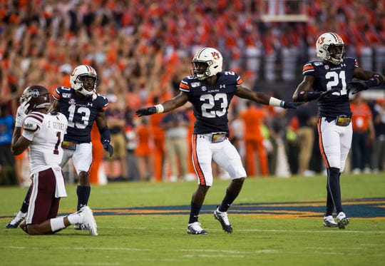 Auburn defensive back Roger McCreary (23) celebrates after deflecting a pass at Jordan-Hare Stadium in Auburn, Ala., on Saturday, Sept. 28, 2019. Auburn defeated Mississippi State 56-23.