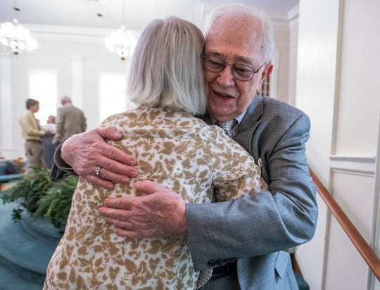 Joe Allen Turner hugs an old friend after he acts as church organist for the final time at First Baptist Church in Wetumpka, Ala., on Sunday September 29, 2019. Turner retired after 63 years as organist at the church.