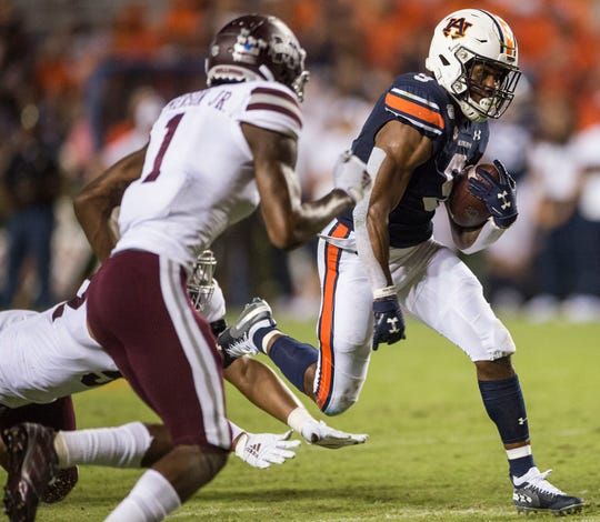 Auburn running back Kam Martin (9) runs the ball at Jordan-Hare Stadium in Auburn, Ala., on Saturday, Sept. 28, 2019. Auburn defeated Mississippi State 56-23.