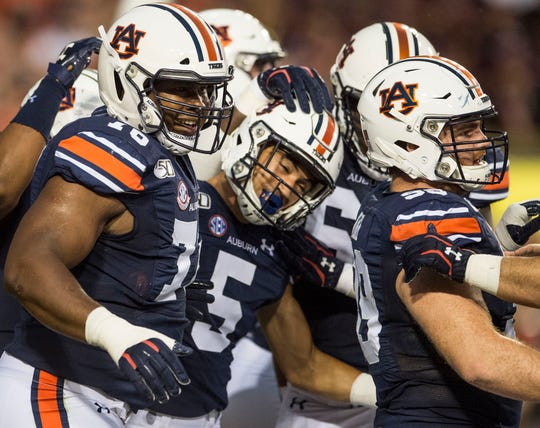 Auburn wide receiver Anthony Schwartz (5) celebrates his touchdown run with his teammates at Jordan-Hare Stadium in Auburn, Ala., on Saturday, Sept. 28, 2019. Auburn leads Mississippi State 42-9 at halftime.