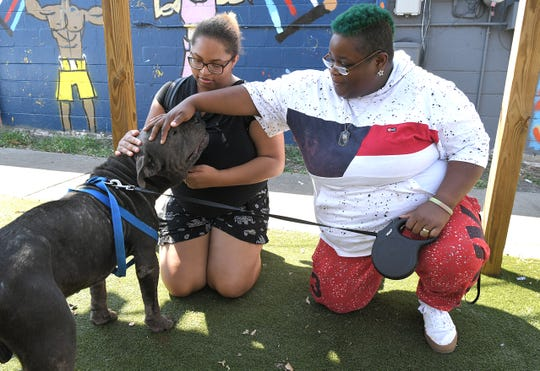 Andrea Mobley and Jessica Strong were once homeless and found help through Nashville's Launch Pad which strives to provide open and affirming safer sleeping shelters for homeless youth in Davidson County.  Mobley and Strong pet their dog, Konnor, outside their apartment complex in Nashville on Friday Sept. 27, 2019.