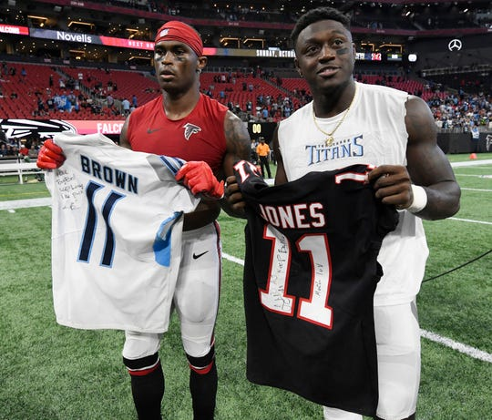 Falcons wide receiver Julio Jones, left, and Titans wide receiver A.J. Brown exchange jerseys after the Titans' 24-10 win Sunday at Mercedes-Benz Stadium.