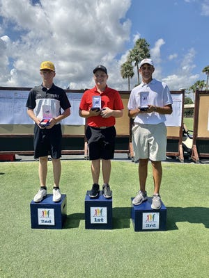 Cape Coral's Kevin Kelly, far left, and Naples' Kody Horton, right, finished second and third, respectively, in the Boys 14-15 Division at the Drive, Chip and Putt Regional at TPC Sawgrass in Ponte Vedra Beach on Saturday, Sept. 28, 2019.