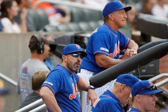 New York Mets manager Mickey Callaway, front left, looks from the dugout during a baseball game against the Atlanta Braves, Sunday, Sept. 29, 2019, in New York. (AP Photo/Kathy Willens)