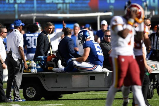 New York Giants linebacker Ryan Connelly (57) is carted off the field after an injury in the second half against the Washington Redskins. The Giants defeat the Redskins, 24-3, in NFL Week 4 on Sunday, Sept. 29, 2019, in East Rutherford.
