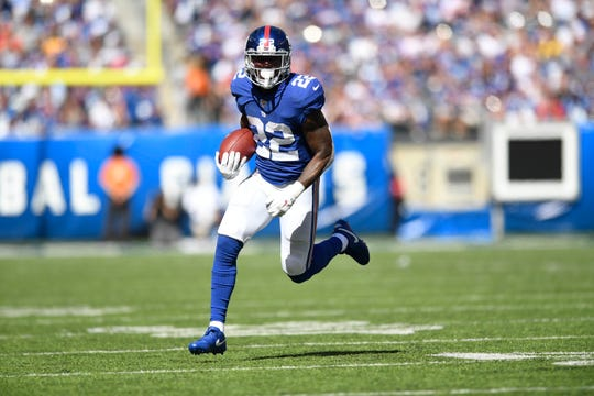 New York Giants running back Wayne Gallman (22) rushes against the Washington Redskins in the first half. Giants host the Redskins in NFL Week 4 on Sunday, Sept. 29, 2019, in East Rutherford.